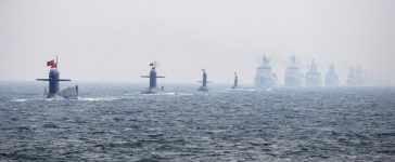 Chinese Navy submarines and warships take part in an international fleet review to celebrate the 60th anniversary of the founding of the People's Liberation Army Navy in Qingdao, Shandong province, April 23, 2009. REUTERS/Guang Niu/Pool
