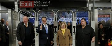 MTA Chairman and CEO Thomas Prendergast (L), New York Governor Andrew Cuomo (2nd L) and Congresswoman Carolyn Maloney (2nd R) walk through the turnstyles at the 96th Street Station during a preview event for the Second Avenue subway line in Manhattan, New York City, U.S., December 22, 2016. REUTERS/Andrew Kelly