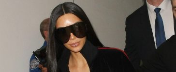 Kim Kardashian jets out of LAX airport in Los Angeles. (Photo credit: Splash News)