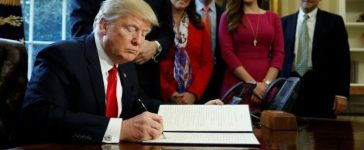 Trump signs an executive order at the White House in Washington