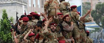 Yemeni soldiers who joined sides with anti-regime protesters ride on a military vehicle and drive through the streets of Sanaa on May 27, 2011. (Photo credit: AHMAD GHARABLI/AFP/Getty Images)