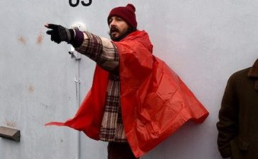 US actor Shia LaBeouf(L) during his He Will Not Divide Us livestream outside the Museum of the Moving Image in Astoria, in the Queens borough of New York January 24, 2017 as a protest against President Donald Trump. LaBeouf has installed a camera at the Museum of the Moving Image in New York that will run a continuous live stream for the duration of Trumps presidency. LaBeouf is inviting the public to participate in the project by saying the phrase, He will not divide us, into the camera. / AFP / TIMOTHY A. CLARY (Photo credit should read TIMOTHY A. CLARY/AFP/Getty Images)