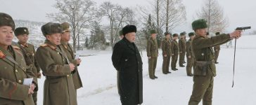 North Korean leader Kim Jong Un (C) stands in the snow as he inspects KPA Unit 1313 honored with the title of O Jung Hup-led 7th Regiment in this undated photo released by North Korea's Korean Central News Agency (KCNA) in Pyongyang December 5, 2014. REUTERS/KCNA