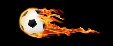 An image of a soccerball on fire (Shutterstock/ jokerpro)