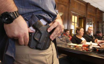 "PROVO, UT - DECEMBER 19: Damon Thueson shows a holster at a gun concealed carry permit class put on by ""USA Firearms Training"" on December 19, 2015 in Provo, Utah. Demand for concealed carry permits have spiked in the last several weeks with the terrorists attacks in Paris and the United States. (Photo by George Frey/Getty Images)"