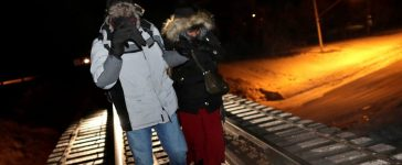 RTS10F1J 26 Feb. 2017 Emerson, Canada Refugees walk along railway tracks from the United States to enter Canada at Emerson, Manitoba, Canada, February 26, 2017. REUTERS/Lyle Stafford