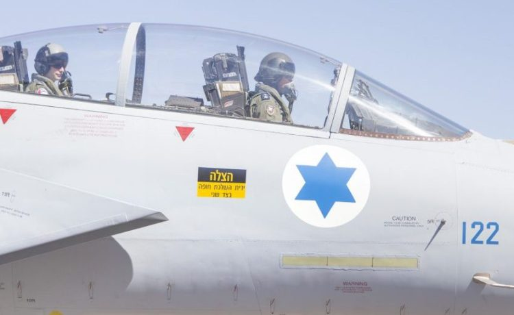 """A plane is fying on the """"Baz"""" (F-15) tail number 122 that was reassembled with the rear of another jet. (Photo: Mor Tzidon/ Israeli Air Force Flickr)"""