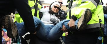 Police remove a protester from ICE detention center in NJ (Getty Images)