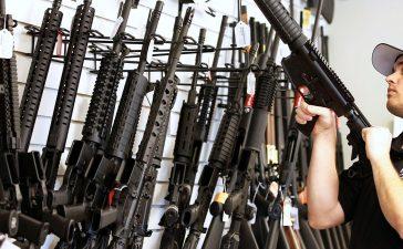 "Salesman Ryan Martinez clears the chamber of an AR-15 at the ""Ready Gunner"" gun store In Provo, Utah, U.S. in Provo, Utah, U.S., June 21, 2016. (PHOTO: REUTERS/George Frey)"