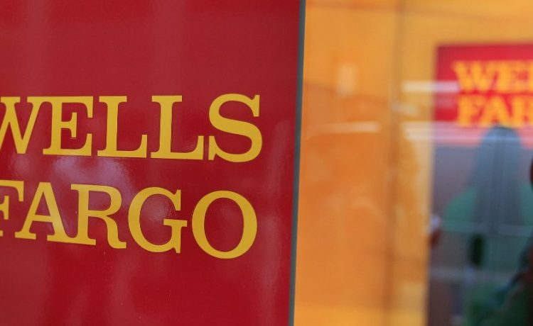 A Wells Fargo sign is seen outside a banking branch in New York (Reuters/Shannon Stapleton)