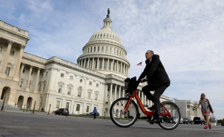A cyclist passes the the U.S. Capitol, on the day the House is expected to vote here to repeal Obamacare in Washington, D.C., U.S., May 4, 2017. REUTERS/Kevin Lamarque