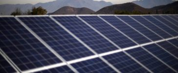 Solar panels are pictured at a solar plant near Santiago,
