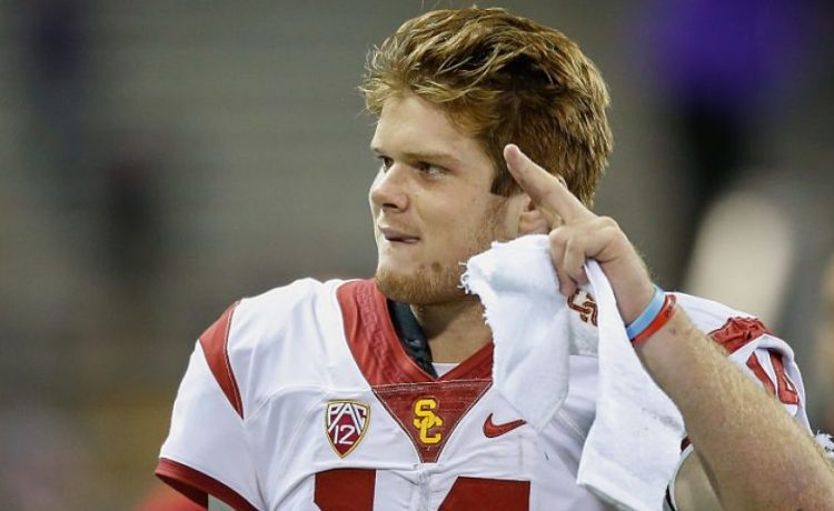 Quarterback Sam Darnold #14 of the USC Trojans waves to the crowd as he heads off the field after beating the Washington Huskies 24-13 on November 12, 2016 at Husky Stadium in Seattle. (Photo by Otto Greule Jr/Getty Images)