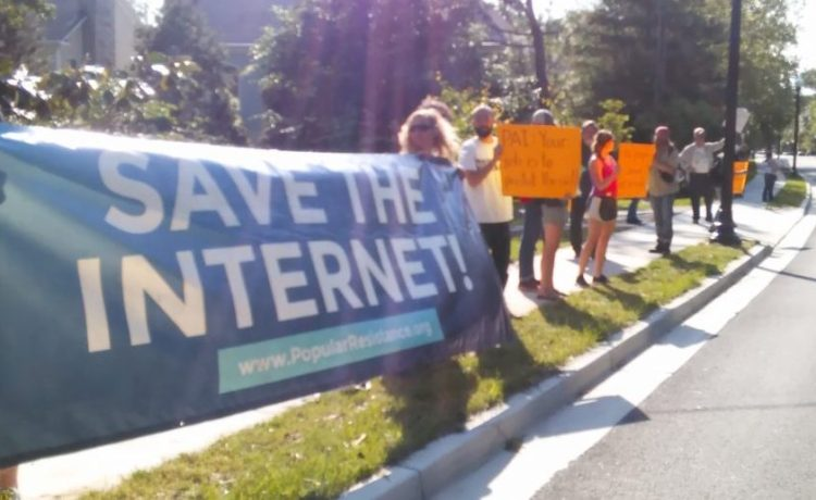 Net Neutrality activists protest outside of the home of FCC Chairman Ajit Pai (Ted Goodman/TheDCNF)