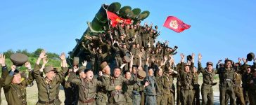 Members of the Korean People's Armed Forces react after doing a test-fire of new cruise rocket in this undated photo released by North Korea's Korean Central News Agency (KCNA) May 30, 2017. KCNA/via REUTERS