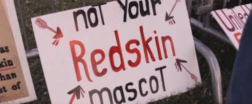Protestors gather outside the Redskins-Cowboys game in 2014. (YouTube Screenshot/startelegramvideo)