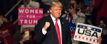 """Shutterstock/ HERSHEY, PA - DECEMBER 15, 2016: President-Elect Donald Trump gives a """"Fist Pump"""" as the confidently arrives on stage to deliver a speech at the """"Thank You"""" Tour rally at the Giant Center."""