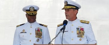 Adm. William Moran, Vice Chief of Naval Operations, turns over command of USS Gabrielle Giffords to Cmdr. Keith Woodley during a commissioning ceremony held at the Port of Galveston in this handout photo