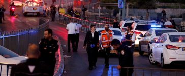 Israeli policemen secure the scene of the shooting and stabbing attack outside Damascus gate in Jerusalem's old city
