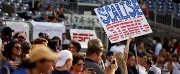 A Republican supporter holds up a sign supporting House Majority Whip Steve Scalise (R-LA) before the Democrats and Republicans face off in the annual Congressional Baseball Game at Nationals Park in Washington, U.S., June 15, 2017. (REUTERS/Joshua Roberts)