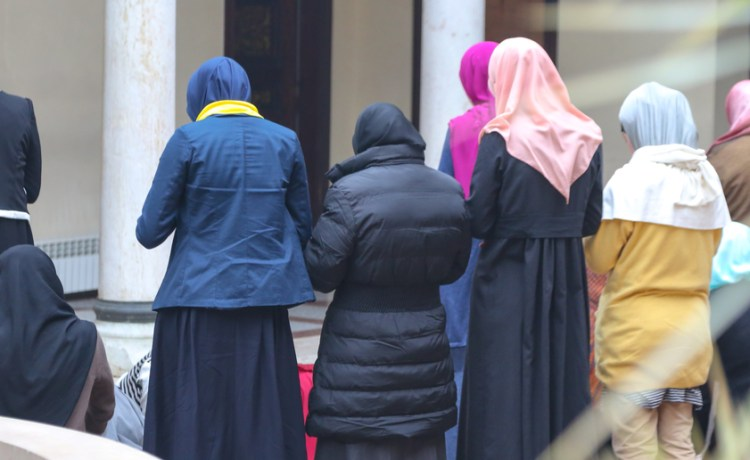 Shutterstock/ Photo of the Prayer performing by muslim women