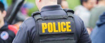 Police uniform on the back of policeman, Ivan Kokoulin/shutterstock_638260507