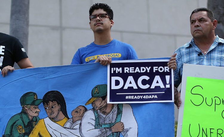 Immigrant families and community members stand together during a press conference to speak about the Supreme Court Oral Arguments that are set to begin on Monday about the DACA/DAPA Executive Actions on April 13, 2016 in Miami, Florida. The Supreme Court will hear on April 18th arguments on United States v. Texas , a case that may determine whether President Barack ObamaÕs immigration programsÑDeferred Action for Parents of Americans and Lawful Permanent Residents (DAPA) and expanded Deferred Action for Childhood Arrivals (DACA), will be able to move forward.Ê (Photo by Joe Raedle/Getty Images)