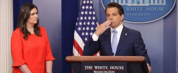 WASHINGTON, DC - JULY 21: Anthony Scaramucci (R) blows a kiss as he and White House Principal Deputy Press Secretary Sarah Huckabee Sanders (L) conduct the daily White House press briefing in the Brady Press Briefing Room at the White House July 21, 2017 in Washington, DC. Scaramucci announced that Huckabee would replace White House Press Secretary Sean Spicer, who quit after it was announced that Trump hired Scaramucci, a Wall Street financier and longtime supporter, to the position of White House communications director. (Photo by Chip Somodevilla/Getty Images)