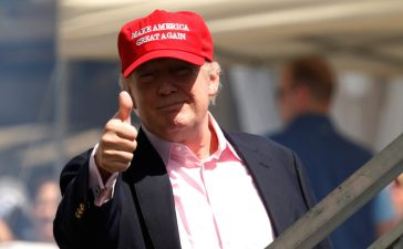 U.S. President Donald Trump gives a thumbs up to supporters as he arrives at the U.S. Women's Open golf tournament at Trump National Golf Club in Bedminster, New Jersey, U.S., July 16, 2017. REUTERS/Kevin Lamarque