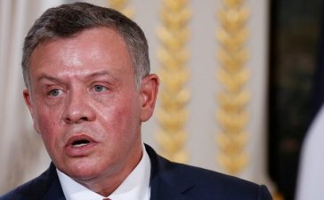 Jordan's King Abdullah attends a joint news conference following a meeting with French president at the Elysee Palace in Paris