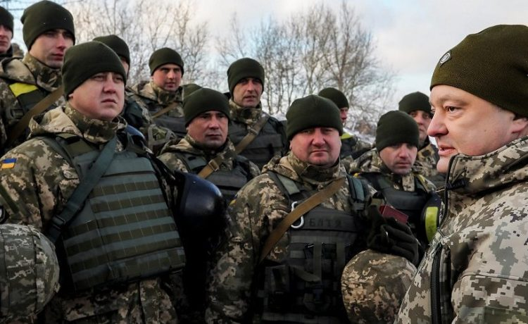 Ukrainian President Poroshenko meets with servicemen during visit to defence post located on troops contact line with Russian-backed separatists in eastern Ukraine near Gorlivka