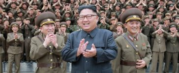 North Korean leader Kim Jong Un claps with military officers at the Command of the Strategic Force of the Korean People's Army (KPA) in an unknown location in North Korea in this undated photo released by North Korea's Korean Central News Agency (KCNA) on August 15, 2017. KCNA/via REUTERS