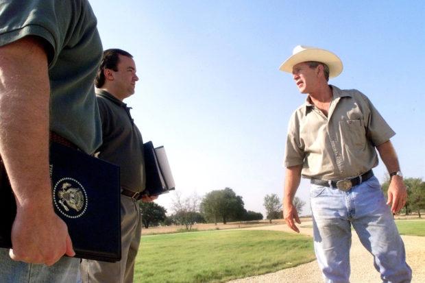 U.S. President George W. Bush talks with Deputy Chief of Staff Joe Hagin and deputy press secretary Scott McClellan on August 6, 2001 at his ranch in Crawford, Texas. (Photo by Eric Draper/White House/Getty Images)