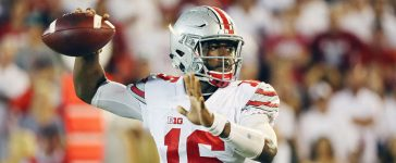 NORMAN, OK - SEPTEMBER 17: J.T. Barrett #16 of the Ohio State Buckeyes looks to passs the football in the second half of their game against the Oklahoma Sooners at Gaylord Family Oklahoma Memorial Stadium on September 17, 2016 in Norman, Oklahoma. (Photo by Scott Halleran/Getty Images)