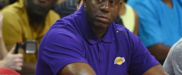 """Los Angeles Lakers president of basketball operations Earvin """"Magic"""" Johnson watches the Lakers take on the Boston Celtics during the 2017 Summer League at the Thomas & Mack Center on July 8, 2017 in Las Vegas, Nevada. Boston won 86-81. NOTE TO USER: User expressly acknowledges and agrees that, by downloading and or using this photograph, User is consenting to the terms and conditions of the Getty Images License Agreement. (Photo by Ethan Miller/Getty Images)"""