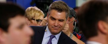 CNN White House correspondent Jim Acosta winks at a fellow reporter after the daily press briefing, during which he had a contentious exchange with White House senior policy advisor Stephen Miller, at the White House in Washington, U.S. August 2, 2017. REUTERS/Jonathan Ernst - RTS1A5QW