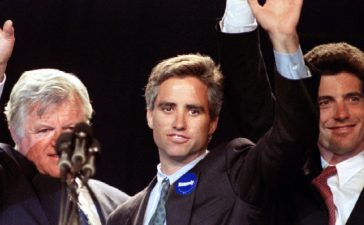 US Senator Edward Kennedy (L) is joined onstage by his nephew Max Kennedy (C) , son of Robert F. Kennedy, and his nephew John F. Kennedy Jr. (R) after Kennedy delivered a speech accepting the Massachusetts Democratic State nomination for US Senator at the Democratic State Convention in Worcester, Massachusetts , June 3 - RTXFD1M