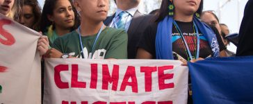 MARRAKESH, MOROCCO - NOVEMBER 9: International youth climate justice activists at the COP22 UN climate conference in Marrakesh, Morocco, react to the U.S. presidential election, November 9, 2016. (Editorial credit: Ryan Rodrick Beiler / Shutterstock.com)