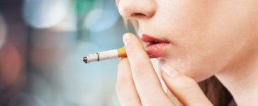 Woman smoking a cigarette (Photo via Shutterstock)