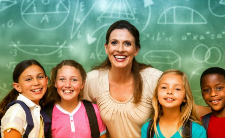 Teacher smiles with students (Shutterstock/vectorfusionart)