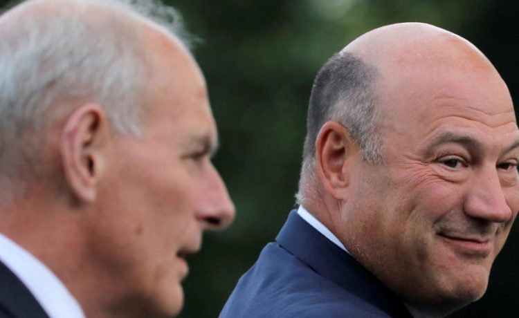 White House Chief of Staff John Kelly and Director of the White House National Economic Council Gary Cohn chat as they arrive with U.S. President Donald Trump (unseen) at White House after a trip to Springfield, Missouri, in Washington D.C., August 30, 2017. REUTERS/Carlos Barria -