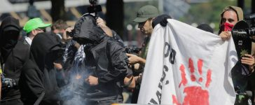 Antifa counter protesters against right-wing group Patriot Prayer light a smoke grenade in Portland, Oregon, U.S. Sept. 10, 2017. Patriot Prayer announced they were moving their Sunday rally from downtown Portland to nearby Vancouver, Washington, citing fears for their safety. REUTERS/Elijah Nouvelage