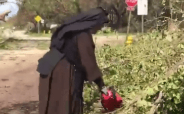 Sister Margaret Ann wields a chainsaw during Irma relief efforts. (Screenshot/Facebook/Miami-Dade Police Department)