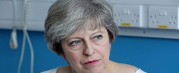 Britain's Prime Minister Theresa May speaks to patients during a round table discussion as they visit the Renal Transplant Unit at the Royal Liverpool University Hospital, Liverpool, Britain, October 12, 2017. REUTERS/Christopher Furlong/Pool