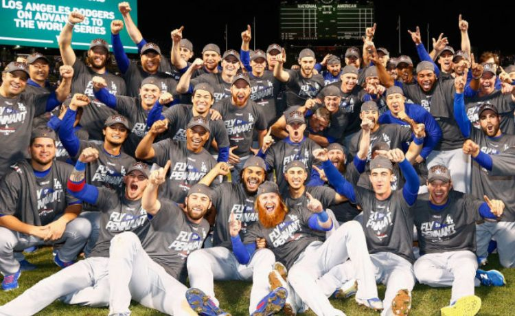 The Los Angeles Dodgers pose after defeating the Chicago Cubs 11-1 in game five of the National League Championship Series at Wrigley Field on October 19, 2017 in Chicago. (Photo by Jamie Squire/Getty Images)