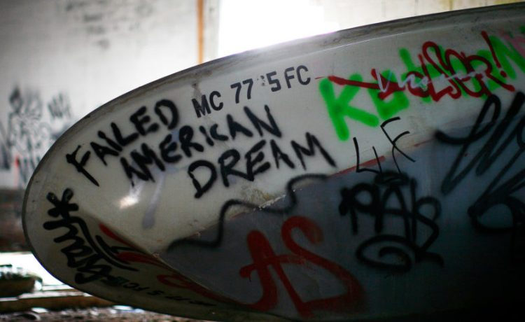 A boat seen inside an abandoned factory in Detroit, Michigan April 2, 2011. April 2, 2011. REUTERS/Eric Thayer/File Photo