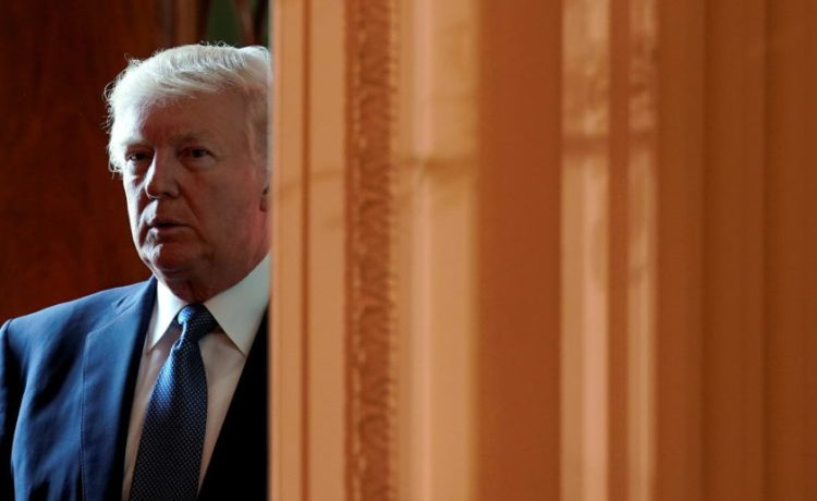 U.S. President Donald Trump enters the East Room to host an event to commemorate Hispanic Heritage Month at the White House in Washington, U.S., October 6, 2017. REUTERS/Kevin Lamarque