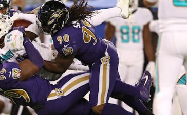 BALTIMORE, MD - OCTOBER 26: Outside Linebacker Matt Judon #99 and defensive end Za'Darius Smith #90 of the Baltimore Ravens tackle wide receiver Jarvis Landry #14 of the Miami Dolphins in the second quarter at M&T Bank Stadium on October 26, 2017 in Baltimore, Maryland. (Photo by Patrick Smith/Getty Images)