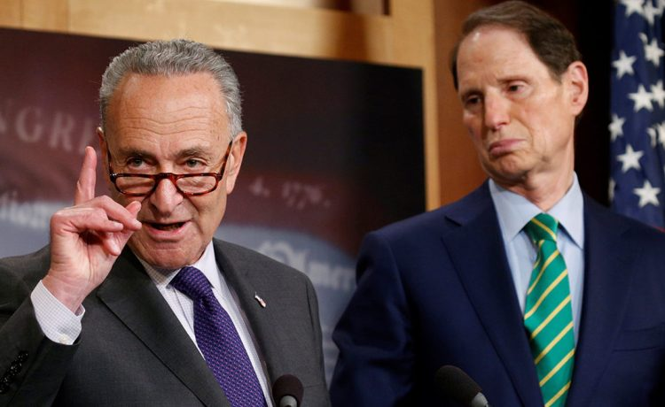 U.S. Senate Democratic leader Chuck Schumer, L, and Senator Ron Wyden (D-OR), the ranking Democrat on the Senate Finance Committee, speak about the Republican tax plan in the U.S. Capitol in Washington, U.S., September 27, 2017. REUTERS/Kevin Lamarque