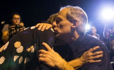 Texas Governor Greg Abbott embraces a woman at a vigil following a mass shooting at the First Baptist Church in Sutherland Springs, Texas, November 5, 2017. Nick Wagner/AMERICAN-STATESMAN via REUTERS